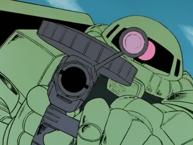 ガンダムに銃を向けるザク